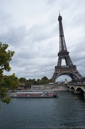 River Boat about to go under Pont d'Lena Bridge Eiffel Tower in the background.jpg
