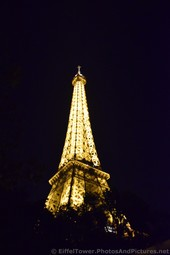 Cross atop of Eiffel Tower at Night.jpg