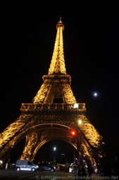 Eiffel Tower at Night next to the Moon Red Light on Pont d'Lena.jpg