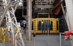 Yellow Eiffel Tower Elevator Arrives on the Second Floor.jpg