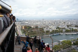 Tourists taking photographs from Eiffel Tower 2nd Level.jpg