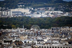 Paris Ferris Wheel and Suresnes France seen from Eiffel Tower.jpg